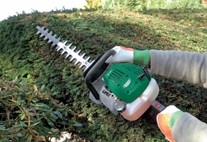 Draper 45575 26CC Petrol Hedge Trimmer in use